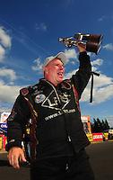 Aug. 7, 2011; Kent, WA, USA; NHRA funny car driver Tim Wilkerson celebrates after winning the Northwest Nationals at Pacific Raceways. Mandatory Credit: Mark J. Rebilas-