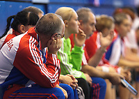 22 OCT 2011 - LONDON, GBR - Coaches and players on the Russian bench watch the Women's 2012 European Handball Championship Handball qualification match against Britain at the National Sports Centre at Crystal Palace (PHOTO (C) NIGEL FARROW)