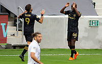 LOS ANGELES, CA - OCTOBER 25: Bradley Wright-Phillips #66 and Diego Rossi #9 celebrate a LAFC goal during a game between Los Angeles Galaxy and Los Angeles FC at Banc of California Stadium on October 25, 2020 in Los Angeles, California.