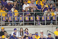 LSU Tiger fans celebrate strike-outs at Alex Box Stadium during an NCAA baseball game against the Mississippit State Bulldogs on March 16, 2012 at Alex Box Stadium in Baton Rouge, Louisiana. LSU defeated Mississippi State 3-2 in 10 innings. (Andrew Woolley / Four Seam Images).