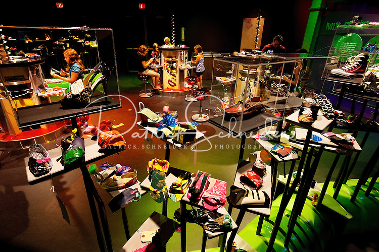 """Visitors to Charlotte's Discovery Place museum are inspired to imagine and innovate with the museum's new """"Think it Up"""" exhibits. Here, kids of all ages design footwear, in the Designing Foodwear exhibit. Discovery Place, Charlotte NC's interactive children's museum, unveiled its interactive exhibits and hands-on activities in June 2010. Renovations of the popular family museum were made possible by the City of Charlotte, the Arts and Science Council and private donations. Discovery Place museum has age-appropriate exhibits for kids of all ages."""