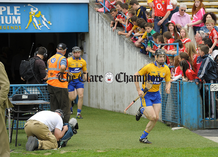 Clare captain Pat Donnellan leads his team out for the Senior hurling championship semi-final at Thurles. Photograph by John Kelly.