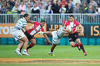 20120803 Copyright onEdition 2012©.Free for editorial use image, please credit: onEdition..Ryan De La Harpe of London Welsh evades the tackle of Jonathan Joseph of London Irish as Peceli Nacamavuto of London Welsh looks on at The Recreation Ground, Bath in the Final round of The J.P. Morgan Asset Management Premiership Rugby 7s Series...The J.P. Morgan Asset Management Premiership Rugby 7s Series kicked off again for the third season on Friday 13th July at The Stoop, Twickenham with Pool B being played at Edgeley Park, Stockport on Friday, 20th July, Pool C at Kingsholm Gloucester on Thursday, 26th July and the Final being played at The Recreation Ground, Bath on Friday 3rd August. The innovative tournament, which involves all 12 Premiership Rugby clubs, offers a fantastic platform for some of the country's finest young athletes to be exposed to the excitement, pressures and skills required to compete at an elite level...The 12 Premiership Rugby clubs are divided into three groups for the tournament, with the winner and runner up of each regional event going through to the Final. There are six games each evening, with each match consisting of two 7 minute halves with a 2 minute break at half time...For additional images please go to: http://www.w-w-i.com/jp_morgan_premiership_sevens/..For press contacts contact: Beth Begg at brandRapport on D: +44 (0)20 7932 5813 M: +44 (0)7900 88231 E: BBegg@brand-rapport.com..If you require a higher resolution image or you have any other onEdition photographic enquiries, please contact onEdition on 0845 900 2 900 or email info@onEdition.com.This image is copyright the onEdition 2012©..This image has been supplied by onEdition and must be credited onEdition. The author is asserting his full Moral rights in relation to the publication of this image. Rights for onward transmission of any image or file is not granted or implied. Changing or deleting Copyright information is illegal as specified in the Copyright, Design and Patents Act