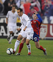 USMNT midfielder Landon Donovan (10) shields the ball while covered from behind by Costa Rica defender Pablo Herrera (17)   The USMNT tied Costa Rica 2-2 on the final game of the 2010  FIFA World Cup Qualifying round at RFK Stadium,Wednesday  October 14 , 2009.
