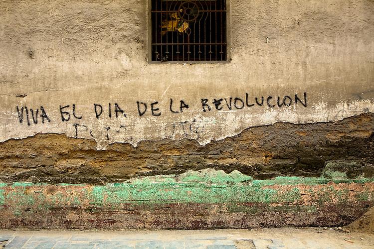 "Textured wall in Quetzaltenango, Western Highlands, Guatemala with grafitti, ""Viva el dia de la Revolucion"""