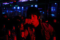 China. Jilin Province. A young man in a nightclub in the town of Yanji, close to the border with North Korea. The town is part of the Korean Autonomous Prefecture in the north-east of the country. 2011