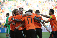 Dirk Kuyt celebrates his goal with teammates, giving the Netherlands a 2-0 lead over Denmark. Holland defeated Denmark, 2-0, June 14th, at Soccer City in the opening match of Group E of the 2010 FIFA World Cup.
