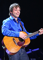 French-Canadian artist Daniel Boucher performs during the St-Jean-Baptist show on the Plains of Abraham in Quebec city June 23, 2009.