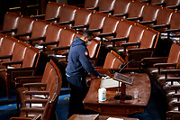 United States Capitol workers disinfect the House floor in the Capitol before members of the 117th Congress are sworn in on Sunday, January 3, 2021. <br /> Credit: Bill Clark / Pool via CNP /MediaPunch<br /> CAP/MPI/RS<br /> ©RS/MPI/Capital Pictures