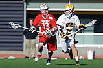 Baltimore, MD - March 3:  Midfielder Bryan Barry #13 of the Fairfield Stags defends Attackman Dave Brown #2 of the UMBC Retrievers during the Fairfield v UMBC mens lacrosse game at UMBC Stadium on March 3, 2012 in Baltimore, MD.