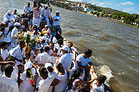 Candomblé devotees sail on Paraguaçu river during the ritual ceremony in honor to Yemanjá, the goddess of the sea, in Cachoeira, Bahia, Brazil, 5 February 2012. Yemanjá, originally from the ancient Yoruba mythology, is one of the most popular ?orixás?, the deities from the Afro-Brazilian religion of Candomblé. Every year on February 5th, hundreds of Yemanjá devotees participate in a colorful celebration in her honor. Faithful, usually dressed in the traditional white, gather on the banks of Paraguaçu river to leave offerings for their goddess. Gifts for Yemanjá include flowers, perfumes or jewelry. Dancing in the circle and singing ancestral Yoruba prayers, sometimes the followers enter into a trance and become possessed by the spirits. Although Yemanjá is widely worshipped throughout Latin America, including south of Brazil, Uruguay, Cuba or Haiti, the most popular cult is maintained in Bahia, Brazil.