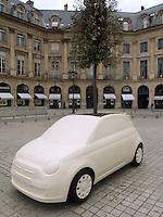 France. Paris. Five fiberglass sculptures from Italian architect and designer Fabio Novembre, inspired by the Fiat 500C model and containing a planted tree, are exhibited on the prestigious Place Vendome in Paris. The exhibition, named 'Un Arbre pour l'Espoir' (A Tree for Hope) will be displaying 12 sculptures from Fabio Novembre, from June 3 to June 29. Since 2005, Designing Hope project has been using  contemporary art as a tool to create awareness in its fight against HIV and Aids-related discrimination. Place Vendôme is a square in the 1st arrondissement of Paris. Its regular architecture by Jules Hardouin-Mansart and pedimented screens canted across the corners give the rectangular Place Vendôme the aspect of an octagon. 12.06.10 © 2010  Didier Ruef