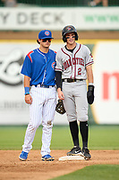 Quad Cities River Bandits Nick Loftin (2) talks with second baseman Bryce Windham (20) during a game against the South Bend Cubs on August 20, 2021 at Four Winds Field in South Bend, Indiana.  (Mike Janes/Four Seam Images)