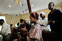 Isattu Jalloh, 11, in the local Baptist church attending a Sunday morning service. The girl is 11 months pregnant and was taken in by Rugiatu Turay, grassroot organizer and paster, after being raped by her uncle. She will deliver her child via C-Section in the local hospital.