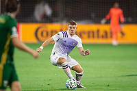 LAKE BUENA VISTA, FL - AUGUST 11: Chris Mueller #9 of Orlando City SC dribbles the ball during a game between Orlando City SC and Portland Timbers at ESPN Wide World of Sports on August 11, 2020 in Lake Buena Vista, Florida.