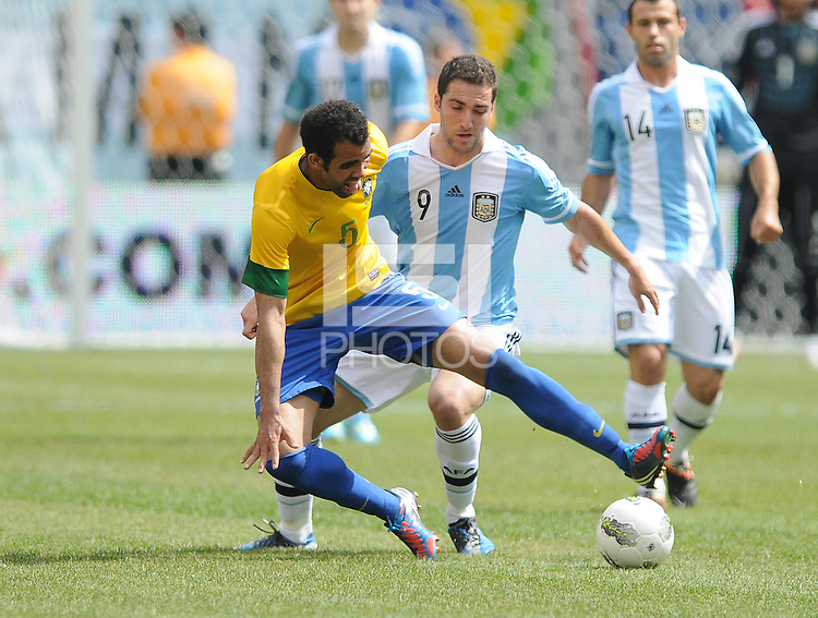 Brazil midfielder Sandro (5) shields the ball from Argentina forward Gonzalo Higuain (9) The Argentina National Team defeated Brazil 4-3 at MetLife Stadium, Saturday July 9 , 2012.