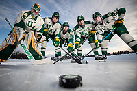 UAA Seawolves Hockey starters pose for a photo on the ice at Anchorage's Westchester Lagoon. From left:  #30 goaltender Kris Carlson, #10 forward Tanner Schachle, #13 forward Alex Frye, #23 forward Eric Sinclair, #24 forward Luc Brown.