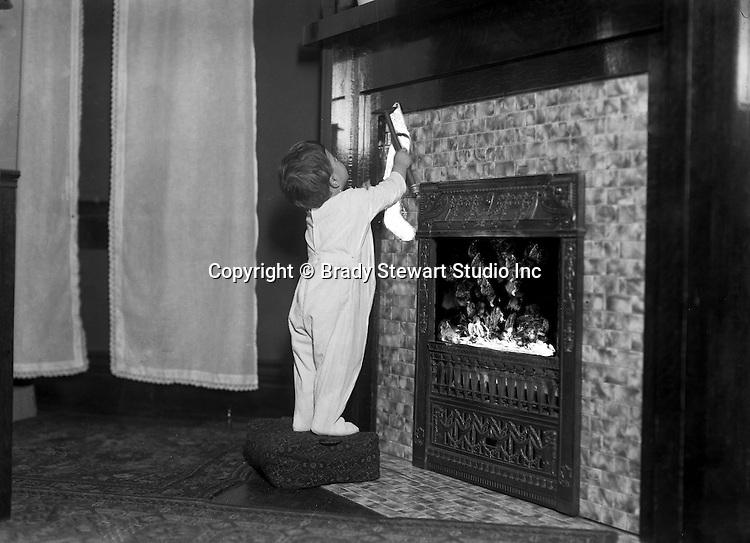 Wilkinsburg PA:  Helen Stewart hanging a Christmas Stocking.