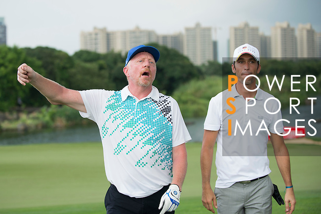 Boris Becker (left) and Luis Garcia at the end of their game during the World Celebrity Pro-Am 2016 Mission Hills China Golf Tournament on 23 October 2016, in Haikou, Hainan province, China. Photo by Marcio Machado / Power Sport Images