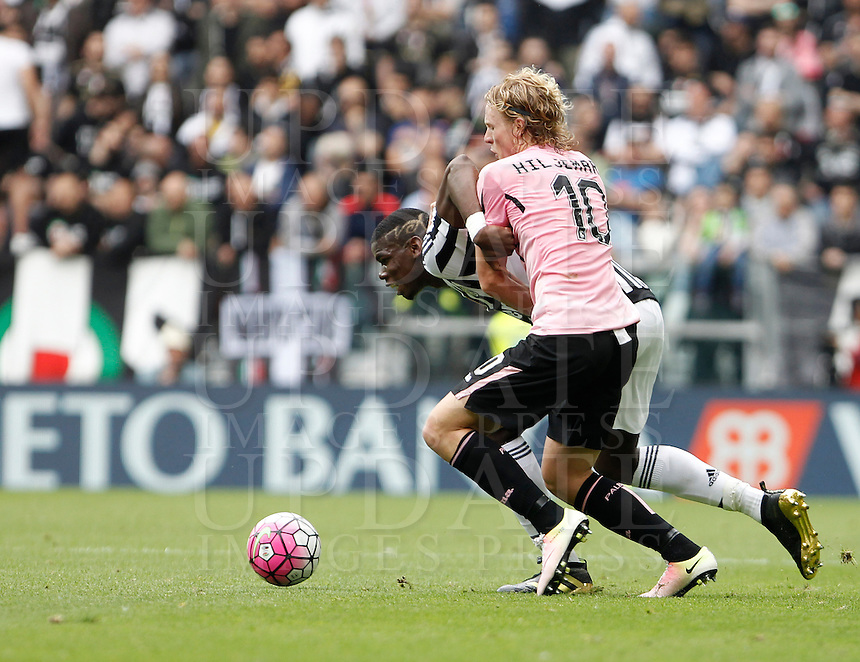 Calcio, Serie A: Juventus vs Palermo. Torino, Juventus Stadium, 17 aprile 2016.<br /> Juventus' Paul Pogba and Palermo's Oscar Hiljemark, foreground, fight for the ball during the Italian Serie A football match between Juventus and Palermo at Turin's Juventus Stadium, 17 April 2016.<br /> UPDATE IMAGES PRESS/Isabella Bonotto