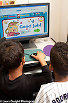 Education Preschool 3-4 year olds two boys playing educational game on computer in classroom