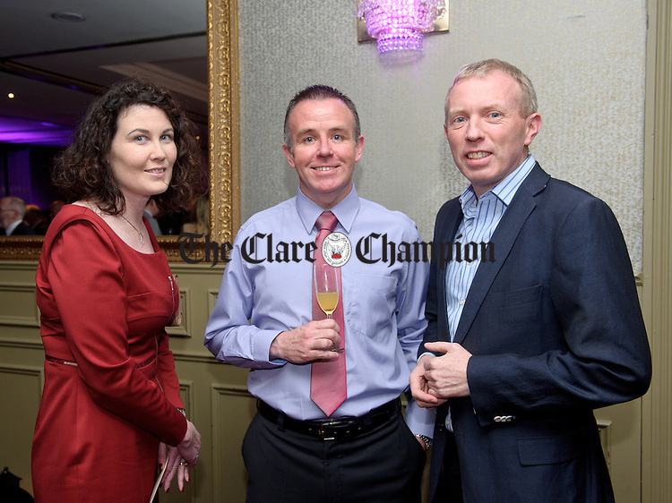 Michael Guerin of Ennis Chamber, centre with Eimear and Timmy Dooley,T.D. at the FBD Clare Business Excellence Awards ceremony in Treacy's West County hotel. Photograph by John Kelly.