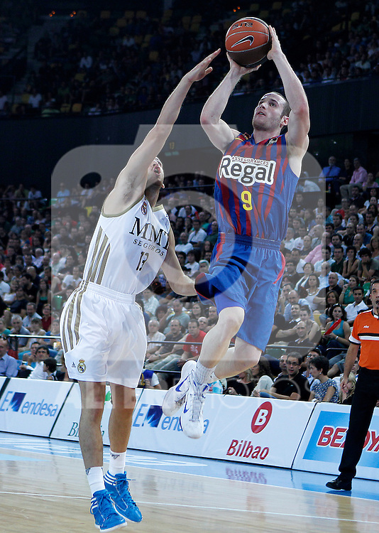 FC Barcelona Regal's Marcelinho Huertas (r) and Real Madrid's Sergio Rodriguez during Supercopa ACB Semifinal match.September 30,2011. (ALTERPHOTOS/Acero)