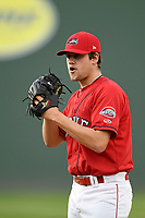 Starting pitcher Hunter Haworth (20) of the Greenville Drive looks for a sign in a game against the Rome Braves on Friday, April 13, 2018, at Fluor Field at the West End in Greenville, South Carolina. Rome won, 10-6. (Tom Priddy/Four Seam Images)