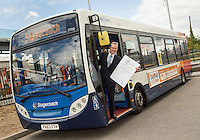 Martin Griffiths, Chief Executive of Stagecoach Group with the Armed Forces Corporate Covenant the company has committed to honour.