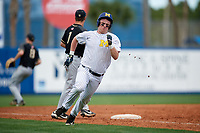 Michigan Wolverines first baseman Jesse Franklin (7) rounds third base to score a run during a game against Army West Point on February 18, 2018 at Tradition Field in St. Lucie, Florida.  Michigan defeated Army 7-3.  (Mike Janes/Four Seam Images)