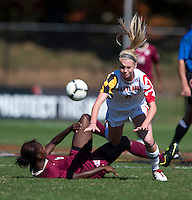 Ashley Spivey (8) of Maryland is fouled by Jessica Price (6) of Florida State during the game at Ludwing Field in College Park, MD.  Florida State defeated Maryland, 1-0.