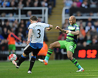 Andre Ayew of Swansea City (right) tries to blocks a pass  from Paul Dummett of Newcastle United during the Barclays Premier League match between Newcastle United and Swansea City played at St. James' Park, Newcastle upon Tyne, on the 16th April 2016