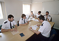Police officers in a meeting...© SHOUT. THIS PICTURE MUST ONLY BE USED TO ILLUSTRATE THE EMERGENCY SERVICES IN A POSITIVE MANNER. CONTACT JOHN CALLAN. Exact date unknown.john@shoutpictures.com.www.shoutpictures.com..