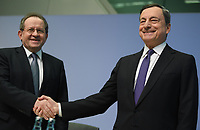 26 April 2018, Germany, Frankfurt: President of the European Central Bank (ECB), Mario Draghi, greeting his deputy Vitor Constancio before the ECB press conference. For Constancio it was the last session as vice president. Europe's top currency guardians have left the central interest rates in the eurozone at a record low of yero percent after their session. Photo: Arne Dedert/dpa