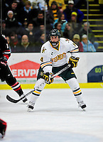 26 November 2010: University of Vermont Catamount forward Anthony DeCenzo, a Freshman from Hibbing, MN, in action against the Northeastern University Huskies at Gutterson Fieldhouse in Burlington, Vermont. The Huskies came back from a 2-0 deficit to earn a 2-2 tie against the Catamounts. Mandatory Credit: Ed Wolfstein Photo
