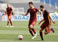 Calcio, Serie A: Lazio vs Roma. Roma, stadio Olimpico, 3 aprile 2016.<br /> Roma's Diego Perotti, left, and Miralem Pjanic in action during the Italian Serie A football match between Lazio and Roma at Rome's Olympic stadium, 3 April 2016.<br /> UPDATE IMAGES PRESS/Isabella Bonotto