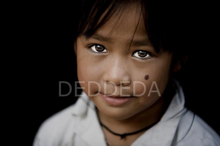 A young girl in rural Laos, near Luang Prabang.