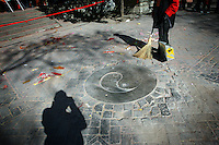 CHINA. A worker sweeping during Chinese New Year in Baiyun Temple in Beijing.  Chinese New Year, or Spring Festival, is the most important festival and holiday in the Chinese calendar In mainland China, many people use this holiday to visit family and friends and also visit local temples to offer prayers to their ancestors. The roots of Chinese New Year lie in combined influences from Buddhism, Taoism, Confucianism, and folk religions.  2008.