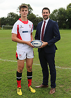 Ulster Rugby Schools 2018-2019<br /> <br /> Regent House player Will Hopes with Danske Bank representative Ian Russell.<br /> <br /> Photo by John Dickson / DICKSONDIGITAL