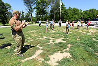COPS AND KIDS SUMMER FUN<br />Maj. Kenneth Paul with the Benton County Sheriff's Office referees a dodge ball game on Tuesday July 13 2021 during the Cops and Kids Summer Games held at the Benton County Sheriff's Office in Bentonville. Deputies and staff hosted dozens of youngsters age 10-12 at the one-day summer games held outside the sherriff's office. Kids enjoyed an array of games and activities under the direction of the Benton County Police Athletic League. The athletic league aims to keep young people out of trouble by channeling their energy into recreational and athletic programs. Go to nwaonline.com/210714Daily/ to see more photos.<br />(NWA Democrat-Gazette/Flip Putthoff)