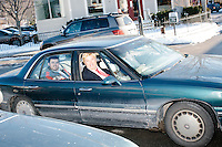 Donald Trump impersonator Eric Jackman, of Jaffrey, New Hampshire, sits in the passenger seat of a car as it drives by after hearing Texas senator and Republican presidential candidate Ted Cruz speak at a town hall event at Peterborough Town House in Peterborough, New Hampshire, on Sun., Feb. 7, 2016.