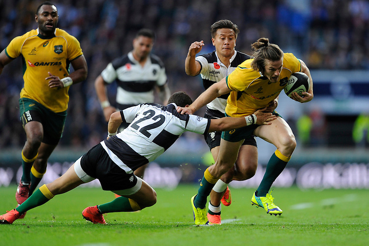 Rob Horne of Australia attempts to evade the tackle of Joaquin Tuculet of Barbarians during the Killik Cup match between Barbarians and Australia at Twickenham Stadium on Saturday 1st November 2014 (Photo by Rob Munro)