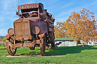 A larger-than-life metal sculpture of a Calistoga Mineral Water Co. truck, complete with a K-9 riding 'shotgun', stands at the company's entrance at one  end of town in Calistoga - a piece of California's Napa Valley wine country.