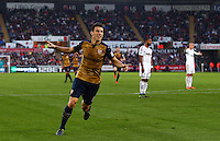 Laurent Koscielny of Arsenal celebrates scoring his goal to make the score 0-2 during the Barclays Premier League match between Swansea City and Arsenal played at The Liberty Stadium, Swansea on October 31st 2015