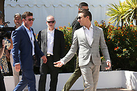 TAYLOR SHERIDAN, THIERRY FREMAUX AND JEREMY RENNER - PHOTOCALL OF THE FILM 'WIND RIVER' AT THE 70TH FESTIVAL OF CANNES 2017