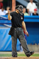 Home plate umpire J.J. Bilinski makes a call during a game between the Batavia Muckdogs and Connecticut Tigers at Dwyer Stadium on July 6, 2012 in Batavia, New York.  Batavia defeated Connecticut 3-2.  (Mike Janes/Four Seam Images)