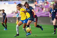 ORLANDO CITY, FL - FEBRUARY 21: Kathleen #2 of Brazil and Alex Morgan #13 of the USWNT battle for the ball during a game between Brazil and USWNT at Exploria Stadium on February 21, 2021 in Orlando City, Florida.