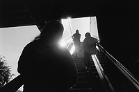 Australia. New South Wales. Sydney. Three women stand on an escalator at Darling Harbour.. 12.3.99 © 1999 Didier Ruef