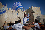 Israelis dance and wave flags outside Damascus gate in Jerusalem Wednesday May 28 2014, marking Jerusalem day. The Day marks the reunification of Jerusalem following the 1967 Six Day War when Israel captured the Arab part of the city from Jordan. Photo By Eyal Warshavsky