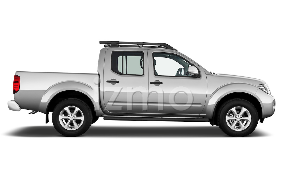 Passenger side profile view of 2010 Nissan Navara LE 4 door Pick-Up Truck Stock Photo